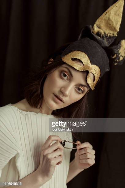 young woman wearing rabbit costume - easter mask stock pictures, royalty-free photos & images