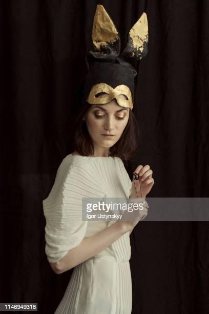 young woman wearing rabbit costume - 頭にかぶるもの ストックフォトと画像