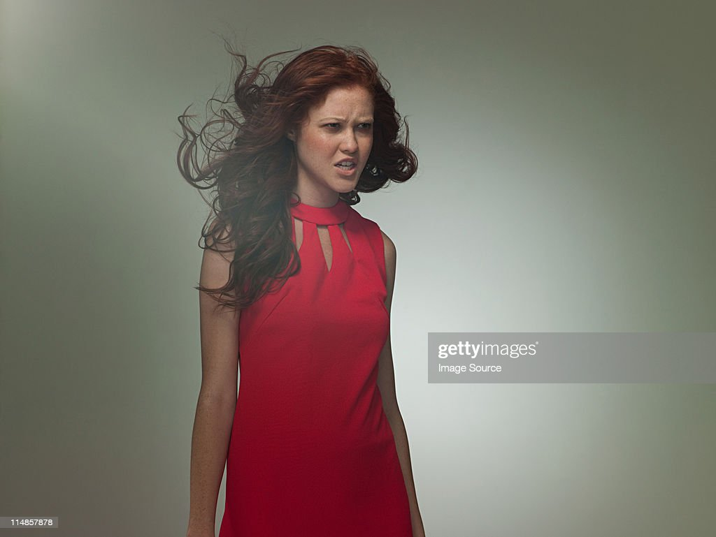 Young woman wearing red dress, portrait : Stock Photo