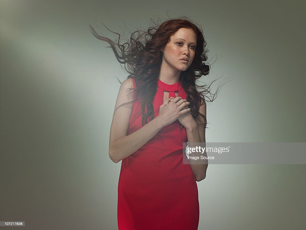 Young woman wearing red dress posing as Aphrodite, portrait : Stock Photo
