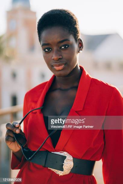 young woman wearing red jackett in the city - jacket stock pictures, royalty-free photos & images