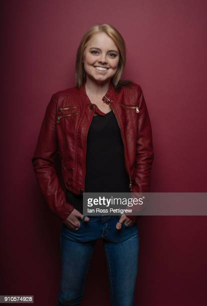 Young woman wearing red leather jacket