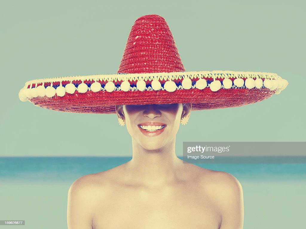 Young woman wearing red sombrero : Stock Photo