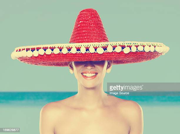 Young woman wearing red sombrero