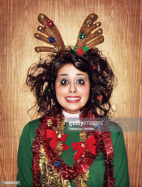 Young woman wearing reindeer antlers