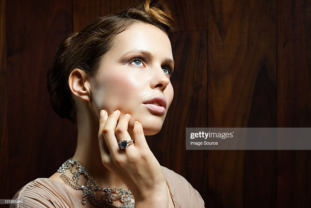 Young woman wearing ring, portrait : Stock Photo