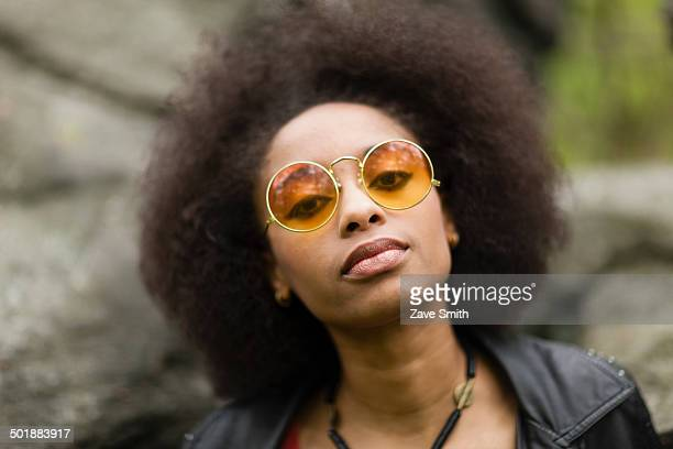 Young woman wearing round sunglasses