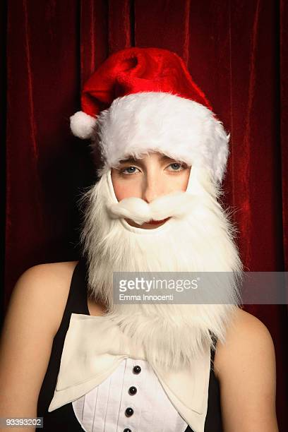 young woman wearing Santa Claus white beard