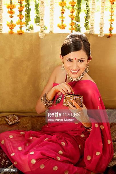 young woman wearing sari and bindi