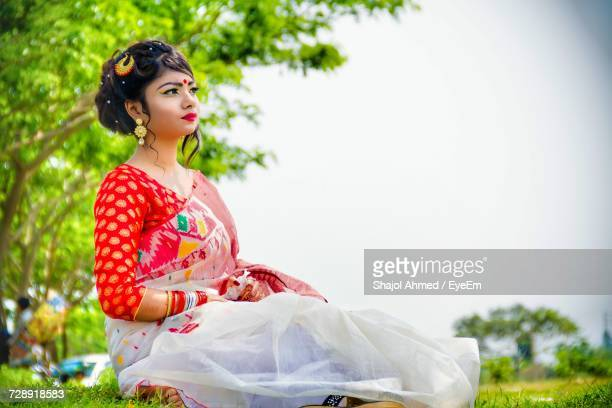Young Woman Wearing Sari On Field Against Sky