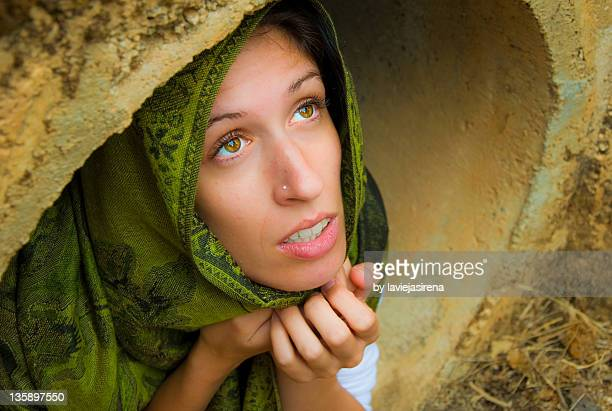 Young woman wearing scarf