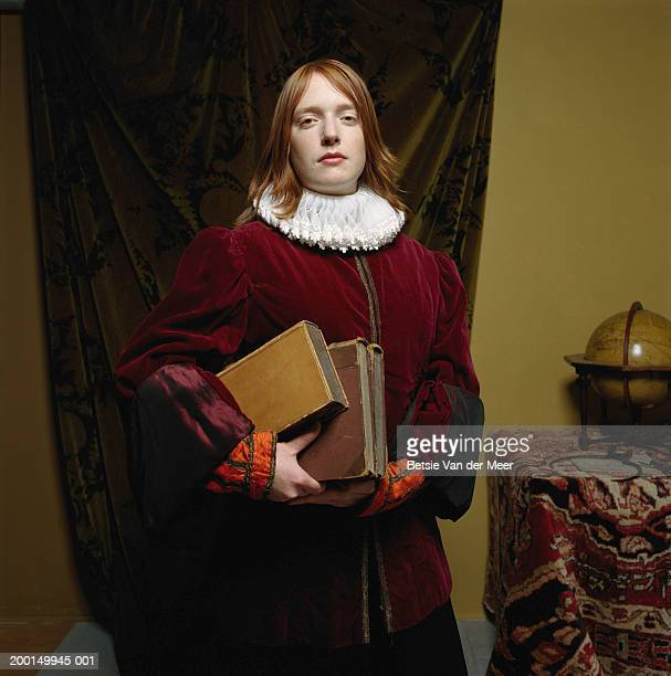 young woman wearing scholar outfit, holding books, portrait - elizabethan ruff stock photos and pictures
