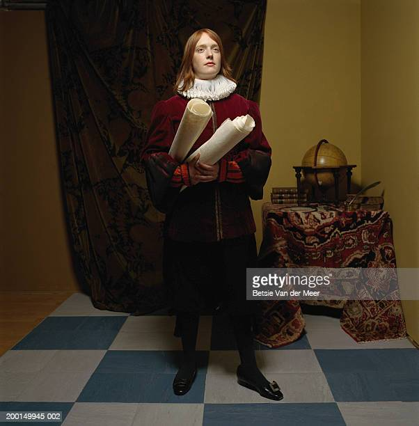 young woman wearing scholar outfit, holding scrolls - elizabethan era stock photos and pictures