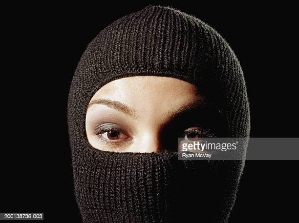young woman wearing ski mask, high section - balaclava stock pictures, royalty-free photos & images