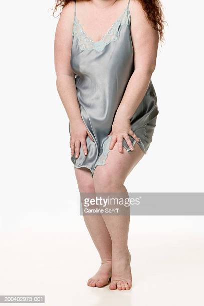 young woman wearing slip, low section - chubby legs stock photos and pictures