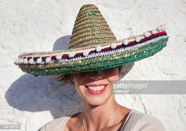 young woman wearing sombrero hat - mexican hat stock pictures, royalty-free photos & images