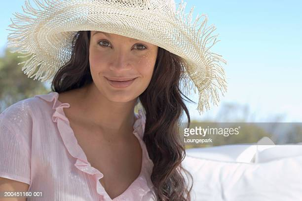 young woman wearing sun hat, smiling, outdoors, close-up, portrait - v neck stock pictures, royalty-free photos & images