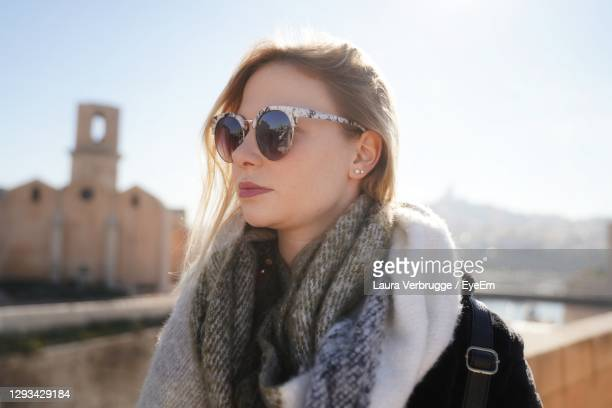 young woman wearing sunglasses against clear sky - bouches du rhone stock pictures, royalty-free photos & images
