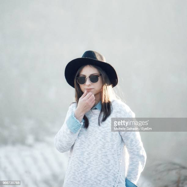 Young Woman Wearing Sunglasses And Hat
