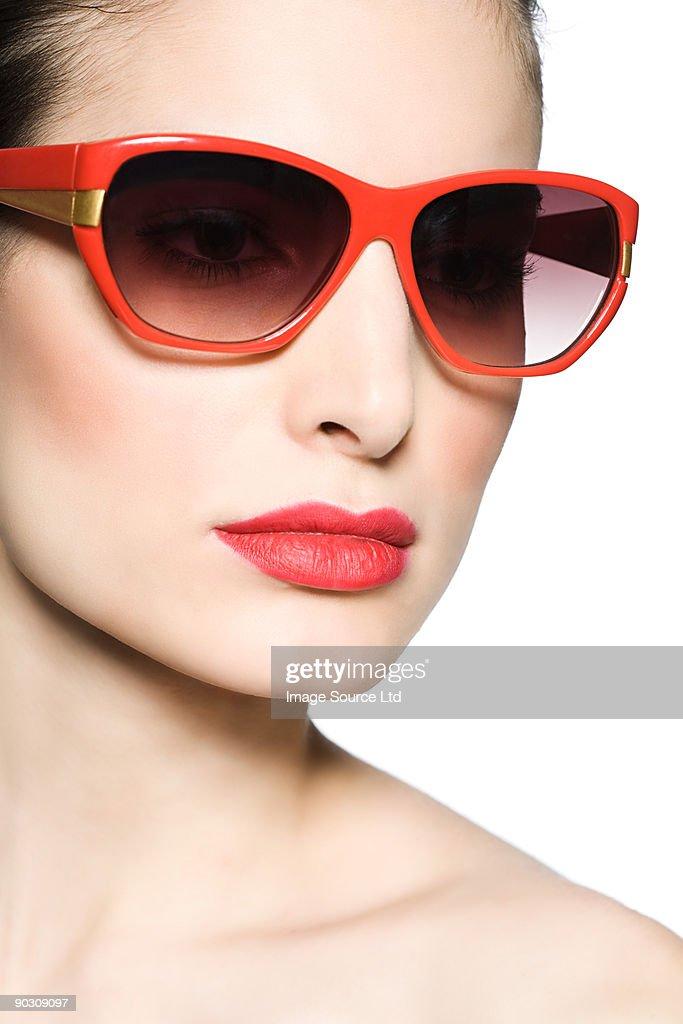 Young woman wearing sunglasses : Stock Photo