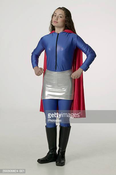 young woman wearing superhero costume, posing in studio, portrait - gray boot stock pictures, royalty-free photos & images
