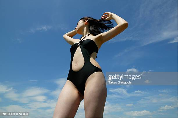 young woman wearing swimwear, low angle view - contea di prince edward ontario foto e immagini stock