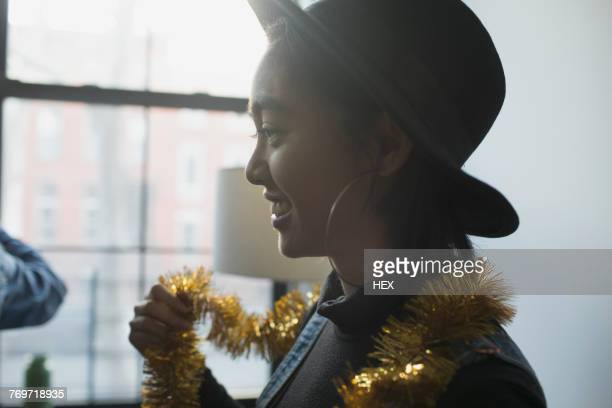 A young woman wearing tinsel