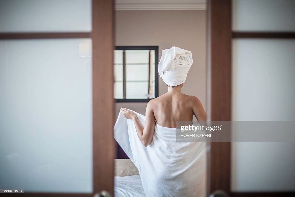 Young woman wearing towel : Stock Photo
