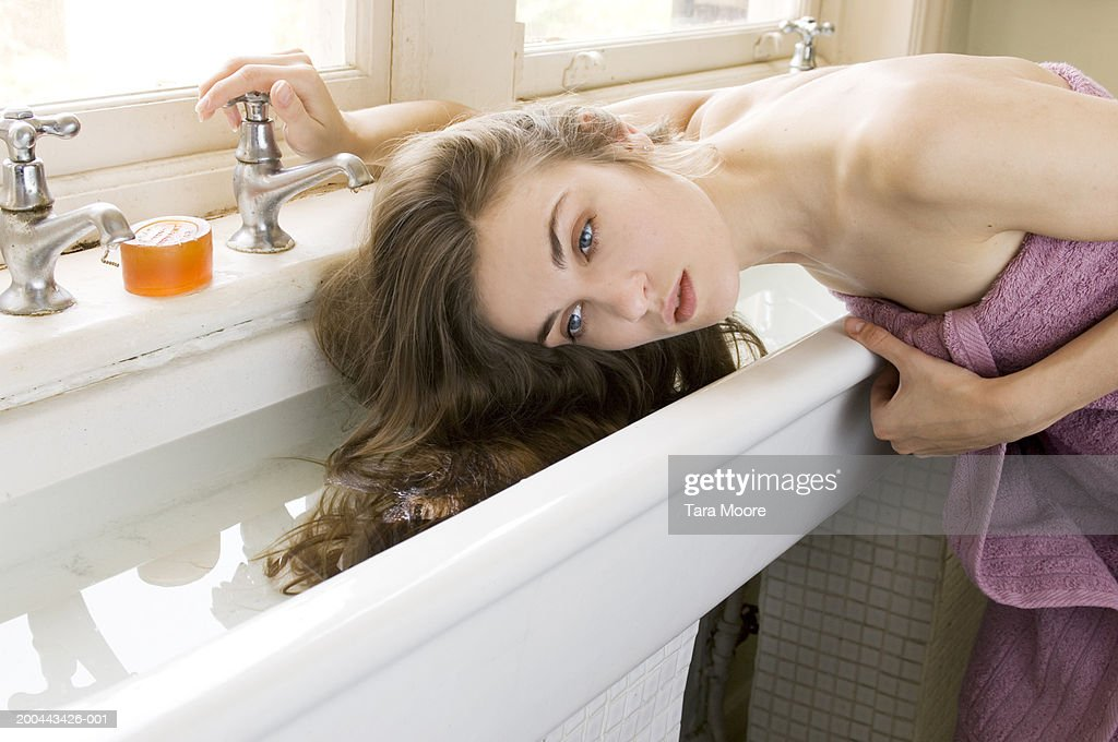 Attirant Young Woman Wearing Towel, Washing Hair In Sink
