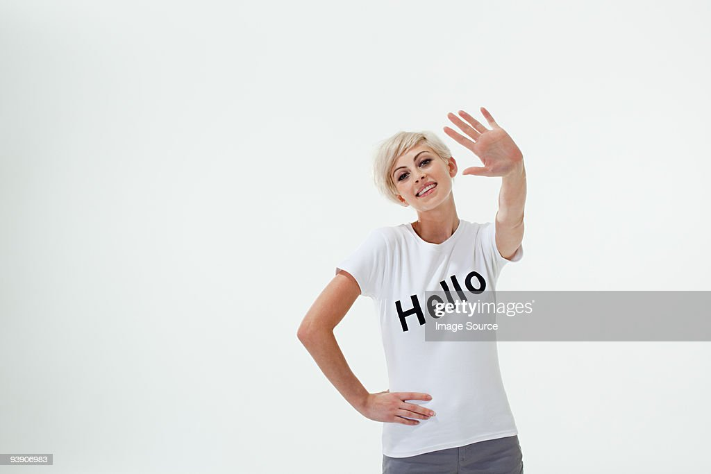 Young woman wearing t-shirt that says hello : Stock Photo