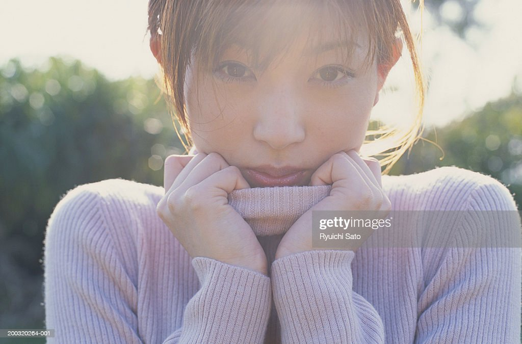 Young woman wearing turtle neck top, close-up, portrait : Stock Photo