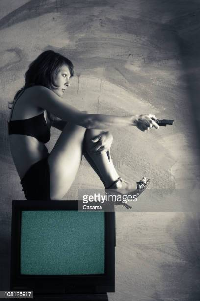 young woman wearing underwear and sitting on top of television - hot glamour models stock pictures, royalty-free photos & images