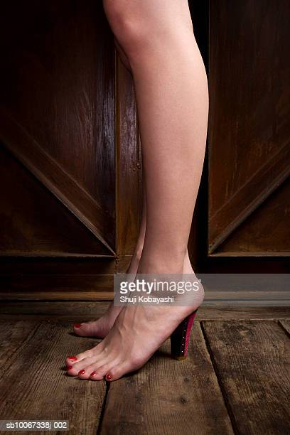 young woman wearing untied high heel, close-up - beautiful legs in high heels stock photos and pictures