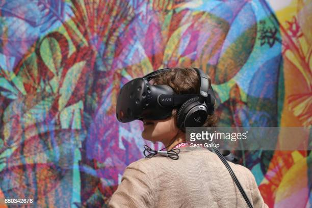 A young woman wearing virtual reality goggles explores a virtual world at a stand at the Republica 17 conference on digital society on May 8 2017 in...
