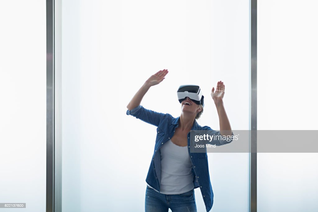 young woman wearing VR Glasses : Stock Photo