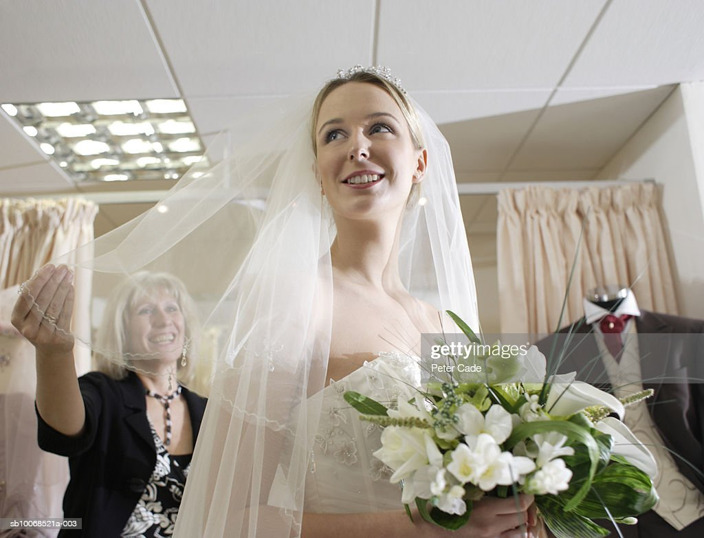 Young Woman Wearing Wedding Dress Mature Woman Holding Veil Stock ...