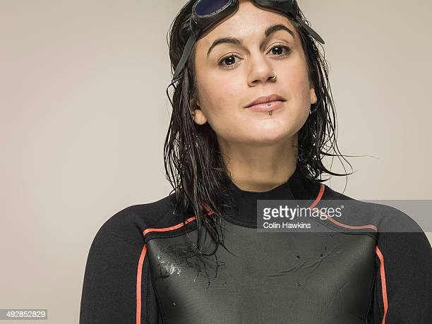 Young woman wearing wetsuit and goggles