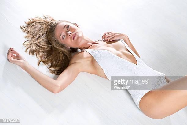 Young woman wearing white bodystocking