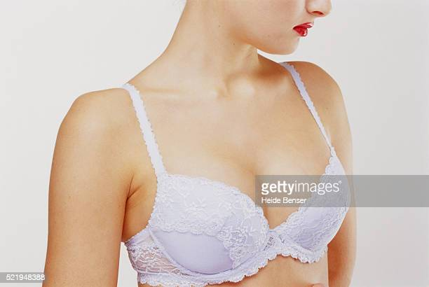 Young woman wearing white bra