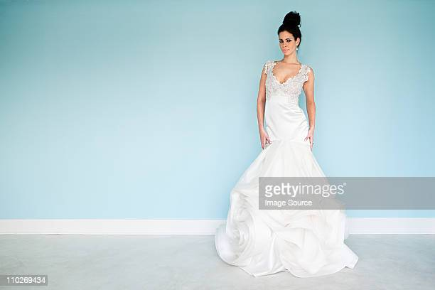 young woman wearing white wedding dress, studio shot - wedding dress stock pictures, royalty-free photos & images