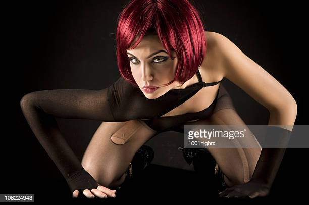 young woman wearing wig on hands and knees - beautiful women in pantyhose stock photos and pictures