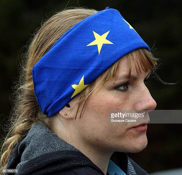 A young woman wears a European flag during the ceremony at the border between the Slovenia Austria and Italy as politicians mark Slovenia's accession...
