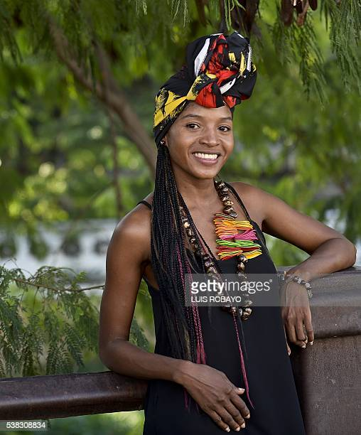 A young woman wears an AfroColombian hairstyle during the 12th contest of Afro hairdressers Tejiendo Esperanzas in Cali Valle del Cauca department...