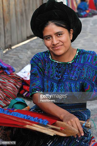 young woman weaving traditional textiles - latin american civilizations stock photos and pictures