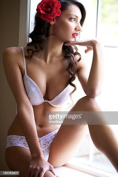 Young Woman White Lingerie in a Window