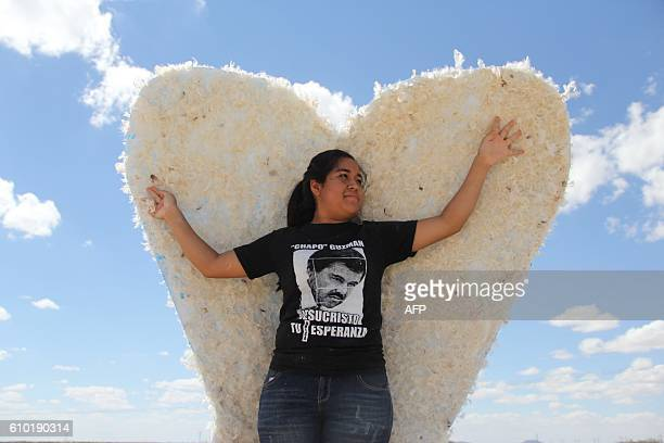 TOPSHOT A young woman who is a member of the 'Psalm 100' evangelical church wears a Tshirt telling drug lord Joaquin 'El Chapo' Guzman that Jesus...