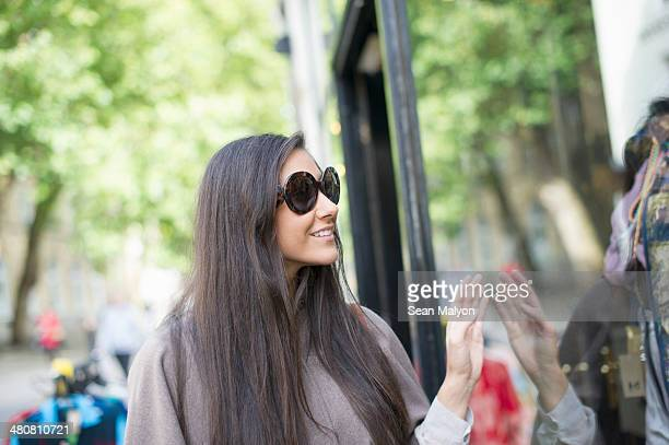 young woman window shopping - sean malyon stock pictures, royalty-free photos & images