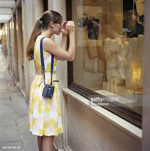 Young woman window shopping, side view