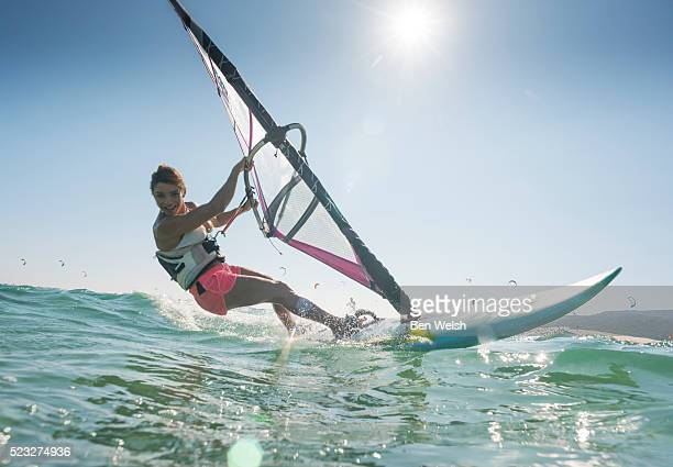 Young woman windsurfing and having fun