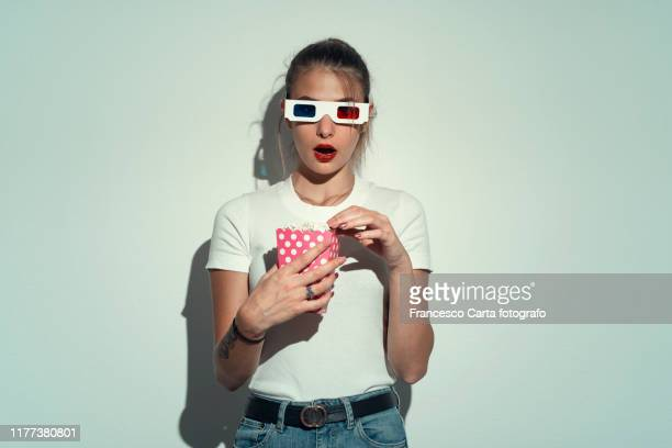 young woman with 3d glasses - relief emotion stock pictures, royalty-free photos & images